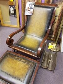 Nice, British Colonial style leather chair and ottoman.