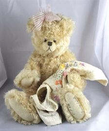 "Lovingly-265. Paula Egbert-Teddy Bear Heaven. In  mohair (distressed)-creamy gold standing at 18"" H  in excellent condition. 1992 Disney Land  Convention-Teddy Bear Classic. Signed. Wears a  pale pink head band with bow."