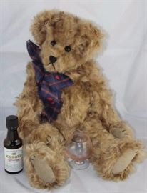 "Brandy-11 Artist bear by Diane B. Suede-brown/tan  in excellent condition. Blue/red hear ribbon neck  bow with small liquor bottle and brandy glass. Size:  14"" H"