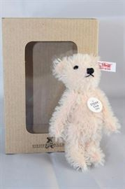 "Rose Teddy Bear - 1006. Steiff U. S. Club 2003  Gift with string plush-rose mohair. 3.5"" H in  excellent condition with box. Has white ear tag  (red printed) with the button and tag specially  sized. Wears a round chest tag ""Steiff Club 2003""."