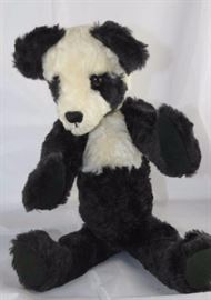 Tgler - 10. By Cynthia Glickman - Willow Creek.  Plush (distressed) black and white. Modeled on the  Chinese Sun Bear (an extinct species). The body  colors (toso) are reversed from the regular panda  colors. Ltd. #1 of 1.