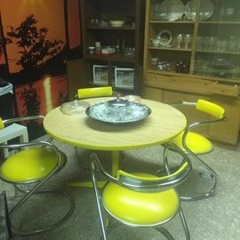 50's chrome yellow round table w 4 chairs,  glasses sets new in box, vintage Pyrex set, lazy Susan crystal divided serving tray, vintage crystal stemware, vintage dining cabinet