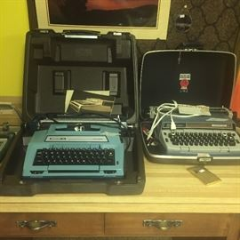 Vintage electric typewriters corona in cases w instruction manuals
