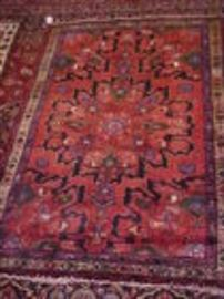 Several various colors & sizes Persian rugs.