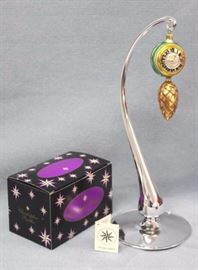 "Christopher Radko ""Time to Spare"" Christmas  ornament.  hand blown and hand painted.  Designer  glass ornaments made in Poland, Germany, Italy, or  Czech Republic.  Stand not included. Size:  5"" H x 2"" W"