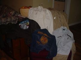 An assortment of old Air Force, Navy and other jackets, and uniforms