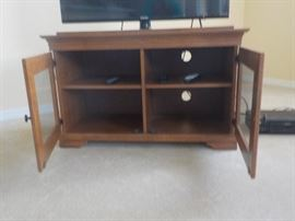 Television Stand with Glass Doors. Light Wood Finish