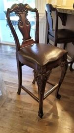 We have a set of these gorgeous bar height stools. Truly beautiful.