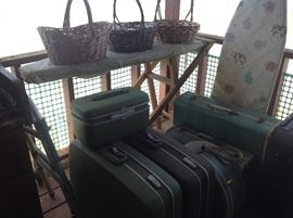 Vintage luggage, and homemade ironing board