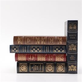 "Easton Press Collector's Edition Novels: A collection of Easton Press collector's edition novels. Included are four books from the ""100 Greatest Books Ever Written"" collection, Vanity Fair: A Novel without a Hero by William Makepeace Thackeray (1979), Madame Bovary by Gustave Flaubert (1978), Jane Eyre by Charlotte Bronte (1978), and The Adventures of Sherlock Holmes by Sir Arthur Conan Doyle (1981). Also included is Buffalo Bill: King of the Old West by Elizabeth Leonard and Julia Goodman (1992). Each book was published by the Easton Press and is presented in a leather bound cover with gilt imprinted pattern work and raised bands to the spine."