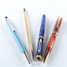 18k Nib On Blu Waterman and Other Pens: An 18k Nib On Blu Waterman and other pens. Collection of pens include an 18K Nib On Blu Waterman fountain pen, and three ball point pens. The Waterman features an alternating blue pattern with 18K gold accents.