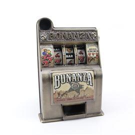 """Bonanza"" Toy Slot Machine: A Bonanza savings bank toy slot machine, manufactured by Radica Games in 2001."
