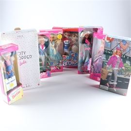 """Collection of Barbie Dolls: A collection of eight Barbie dolls. The dolls include: """"Pepsi Spirit"""" Barbie, """"Horse Riding"""" Barbie, """"Shopping Time"""" Barbie, """"Ocean Friends"""" Barbie and Baby Keiko the whale, """"Fantasy Ball"""" Barbie, """"American Beauty Queen"""" Barbie, """"City Shopper"""" Barbie designed by Nicole Miller, and """"Barbie at Bloomingdales""""."""