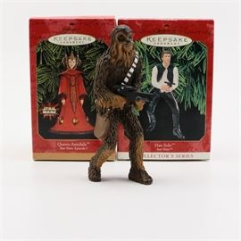 """Hallmark """"Star Wars"""" Keepsake Ornaments: A grouping of Hallmark Star Wars Keepsake Ornaments. This grouping features three character ornaments from the Star Wars franchise. Included is Chewbacca, Han Solo, and Queen Amidala. The ornaments are marked to the undersides and the original boxes are included."""
