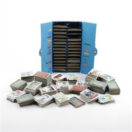 Baseball Cards and Sorting Box: A collection of baseball cards. This collection contains several hundred circa 1977 baseball cards of various players and teams. Some of the collection is held in a segmented card box that is in the form of a sports locker; with each section featuring sorted sections of cards based on the team.