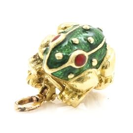 18K Yellow Gold Hidalgo Enamel Frog Converter Brooch: An 18K yellow gold enamel frog converter brooch. This brooch features a three- dimensional frog motif with transparent green enamel on the body and transparent red enamel for the eyes. There is a hinged bail on the back to convert the brooch to a pendant.