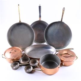 Copper Plated Kitchen Pots and Pans: A group of copper plated pots and pans. There are approximately eleven items in total with a sauté pan and gratin pans by Revere with rondeaus featuring one by Copral. Additional pots and pans included including sauce pots.