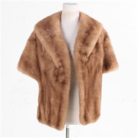 Women's Vintage Mink Fur Stole: A women's vintage blonde mink stole by Canada Majestic Mink. This stole features a shawl collar, inseam pockets and a taupe satin lining. A cloth label and monogram have been sewn into the lining.