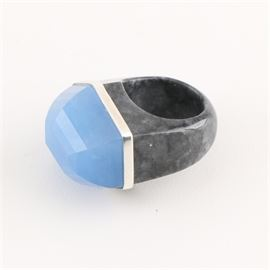 Sterling Silver Black and Dyed Jadeite Ring: A sterling silver black and dyed jadeite ring. This ring features a dyed blue jadeite stone in a bezel of sterling silver affixed to the carved black jadeite shank.