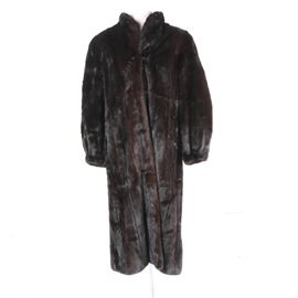 Vintage Beaver Full-Length Coat: A vintage beaver full-length coat. This coat has a stand-up collar, a hook and eye closure, full-length sleeves and charcoal lining. Cloth labels and a monogram are sewn into the lining.