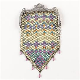 "1920s Mandalian Purple and Orange Enamel Mesh Handbag: A circa 1920s Mandalian purple and orange enamel mesh handbag. This bag features a colorfully painted exterior with purple orange and blue designs. It has a hinged opening decorated with filigree patterns and purple bead fringe. The bag has a chain handle and is stamped ""Mandalian""."