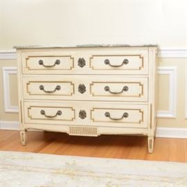 Vintage Marble Top Commode by Pogue's: A vintage Pogue's French provincial design marble top commode. Designed marble top and three stacked drawers with cut corner panels with gold tone painted accents. Large ornate pulls with escutcheon centers. Columned grooved arched sides to tapered feet. Thee stacked and divided drawers with dovetail construction. Companion to item 17CIN433-237.