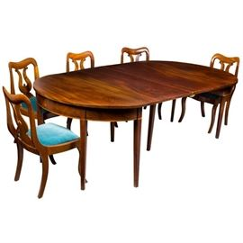 This is a photo of a similar table set up.  The one at the sale also has a leaf which makes it seat 12.