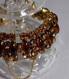 Amber glass and paste rhinestone bracelet in gold wash. Purchase now at: www.manorbornestatesales.com