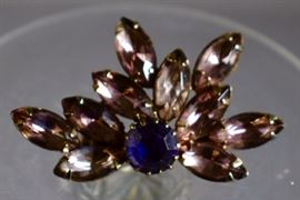 Lavender and sapphire blue rhinestone brooch. Purchase now at: www.manorbornestatesales.com