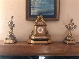 Victorian French Ormulu Mantel Clock Bronze Cherbs Cloisonné Dial face with cloisonné band also with cherubs with matchingcandelabra