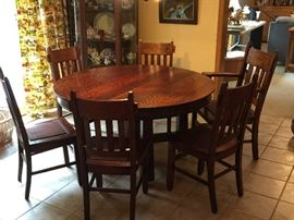 Antique mission table with 6 chairs and 4 leaves