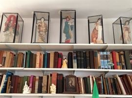 antique books and Japanese dolls