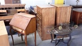 Desks, chests of drawers, mid-century metal wall decoration.