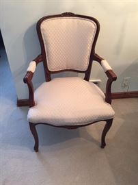 Mid Century Armchair With Decorative Back.