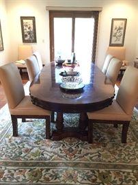 Burlwood dining table on column legs