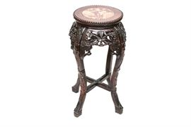 Antique Carved Rosewood Jardiniere Stand: A Chinese early 20th century carved rosewood jardiniere stand. This small table features a round stone slab inset to a beaded-edge top, a heavily carved reticulated apron, and cabriole legs with a low x-stretcher.