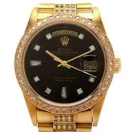 Rolex Day-Date 18K Yellow Gold 3.10 CTW Diamond Wristwatch: A Rolex Day-Date 18K yellow gold wristwatch, model 18238, featuring an aftermarket diamond dial, diamond bezel, and an original band with aftermarket diamonds.