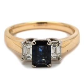 14K Yellow Gold and Platinum Natural Blue Sapphire Diamond Ring: A 14K yellow gold ring featuring platinum prongs with a natural blue sapphire to the center and a diamond to either side.