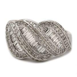 14K White Gold 1.47 CTW Diamond Statement Ring: A 14K white gold statement ring featuring a woven design comprising baguette cut and round cut diamonds.