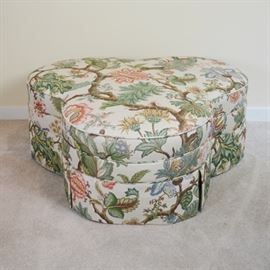 "Stanford Furniture Botanical Upholstered Trefoil Ottoman: A botanical upholstered trefoil-shaped ottoman. This three lobed ottoman features a botanical style upholstery across leafy branches. It includes matching welting with a tailored ottoman skirt and three casters. The seat includes a blend of urethane foam and synthetic fibers. Marked ""Stanford Furniture Corporation."""
