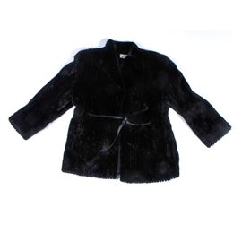 "Vintage Black Mink Fur Coat: A vintage black mink fur coat. The hip-length, belted fur coat is made from very dark brown, nearly black mink, featuring long sleeves and a black leather belt. It is lined with black satin, and is labeled ""The Denver""."