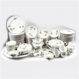 "Large Set of Japanese Narumi China Dinnerware: A 163-piece set of Japanese vintage Narumi China dinnerware. The service features white porcelain decorated with light and dark green bamboo, accented with gold luster. The set includes two lidded dishes, two creamer pitchers, two sugar bowls, two gravy boats, two small oval serving dishes, an oval bowl, twenty-four dinner plates, twenty-four bread plates, twenty-three salad plates, twenty-three soup bowls, eighteen small bowls, fourteen teacups, and twenty-four saucers. The set is marked ""Narumi China – Japan""."
