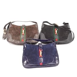 "Three Leather Frame Hand Bags: A set of three matching leather frame hand bags in three colors. Included are blue, brown, and black frame hand bags. All bags are marked ""yfc"" on the zippers. These handbags match the tote bags in this sale under number 17DEN121-009."