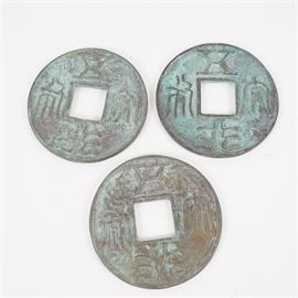 Set of Three Medallions Patterned After Ancient Chinese Coins: A set of three decorative medallions patterned after ancient Chinese coins. Each features raised characters to the edges, a square hole to the center and an applied green patina. No maker's marks were found.
