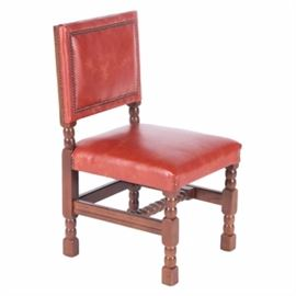 "Jacobean Style Chair by Empire State Chair Company: A Jacobean style chair by the Empire State Chair Company. This reddish orange ""faux"" leather chair features a squared backrest with brass nail head trim over a padded square seat. It stands on thick bobbin turned legs with a ""U"" stretcher support including a turned central stretcher."