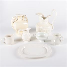 "White Kitchen Decor Featuring ""Maria"" by Rosenthal: A white kitchen decor collection featuring _Maria _ by Rosenthal. This assortment includes an urn shaped lamp base with twin handles, a large embossed pitcher, three creamers a cup and tureen platter. Items are white porcelain with maker mark ""Rosenthal Germany _Maria _ to the bottom of the cup."