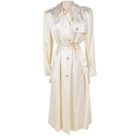 Women's Trench Coat for Newman-Marcus: A women's trench coat for Neiman-Marcus in size 12. The full-length trench features a classic storm coat design in a high sheen ivory hued fabric with rhinestone encrusted buttons. A full lining completes the design.
