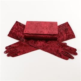 John Koch One-of-a-Kind Handbag and Gloves: A John Koch One-of-a-Kind handbag and gloves. This collection includes a folding red faux snakeskin clutch with a snap closure. It has a black cloth lining and a pair of red bracelet length gloves with a faux snakeskin pattern.
