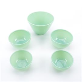Fire King Green Glass Jadeite Mixing Bowls: A set of Fire King green glass Jadeite mixing bowls. Included in this collection are two small, two medium, and one large mixing bowl. Maker's marks present on the underside.