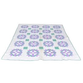 "Hand Made ""Laurel Wreath"" Pattern Quilt: A handmade Laurel Wreath quilt. This quilt features a lavender and turquoise colored variation of the Laurel Wreath pattern throughout, and has turquoise binding. There are no visible maker's marks."